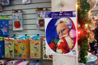 """ABINGTON, MA, December 7, 2013 — The Christmas Place sells many miscellaneous Christmas and holiday items, such as """"toilet tattoos,"""" which are adhesive and can stick to customers' toilet lids."""