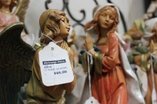 ABINGTON, MA, December 7, 2013 — A 12-inch tall ceramic religious figurine was priced at almost $100. The angel sits on one of just five shelves of religious-themed merchandise at The Christmas Place.