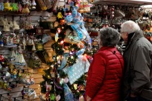 ABINGTON, MA, December 7, 2013 — Linda Coles of Bedford, N.H. and her husband admire an elaborately decorated plastic Christmas tree in one of The Christmas Place's many aisles. They came to the store to do some holiday shopping with their daughter and her husband (not pictured).