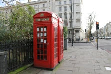 Two of London's famous red telephone booths, spotted in South Kensington.