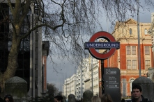 """A tube stop, marked by the signature """"UNDERGROUND"""" sign."""