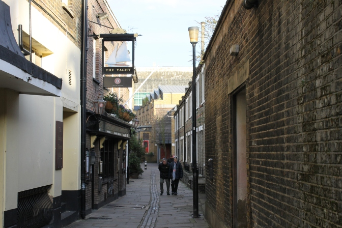 A winding alleyway in Greenwich, London, packed tightly.
