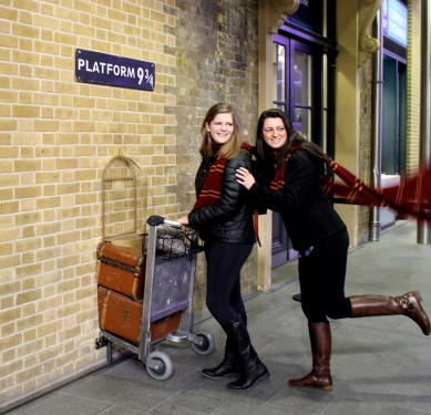 """My roommate and I, posing for the camera at """"Platform 9 and 3/4,"""" of Harry Potter fame."""
