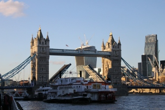 The Tower Bridge, raised for boats to pass through.