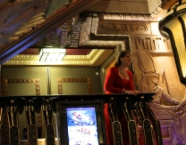 """Once inside, this opera singer serenaded shoppers who were riding up and down Harrods """"Egyptian escalators."""""""