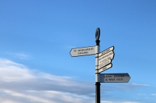 Signs point the way to different attractions at Edinburgh Castle.