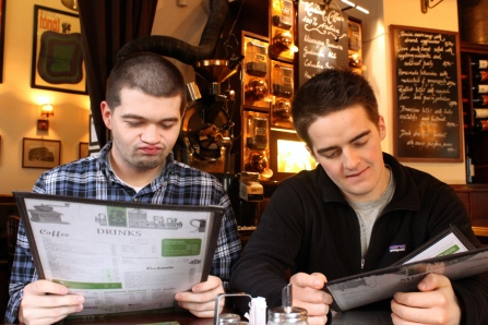 Conor and CJ, two friends from my program, peruse the menu at Budapest's Cafe Alibi.