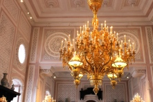 A gorgeous chandelier inside the palace.